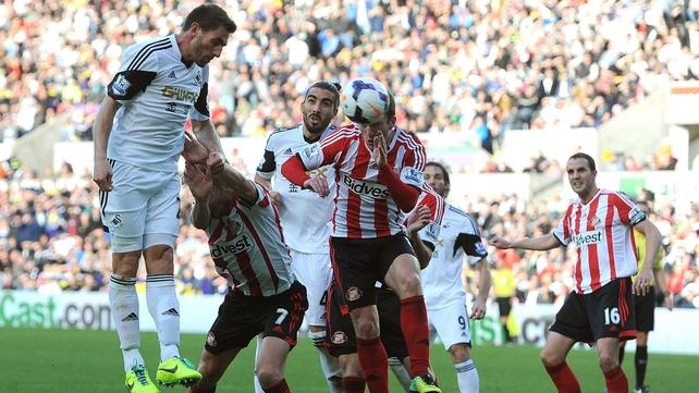 Angel Rangel heads Swansea in front against Sunderland