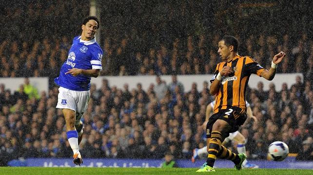 Steven Pienaar slots home Everton's second goal at Goodison Park
