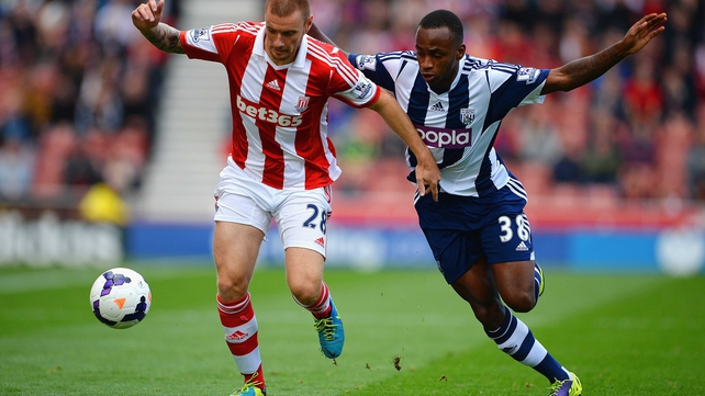 Andy Wilkinson of Stoke City and Saido Berahino of West Brom battle for possession