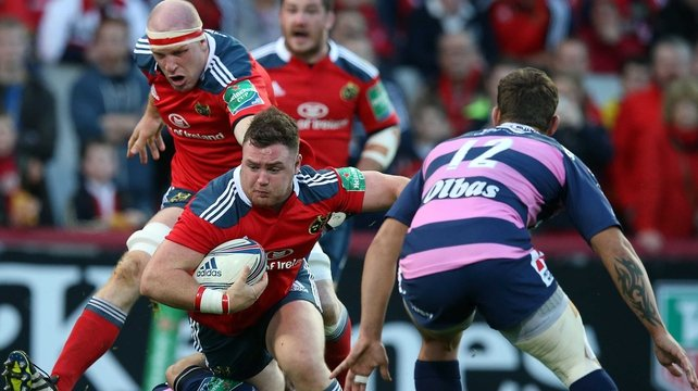 Munster's Dave Kilcoyne is tackled by Jonny Bentley of Gloucester