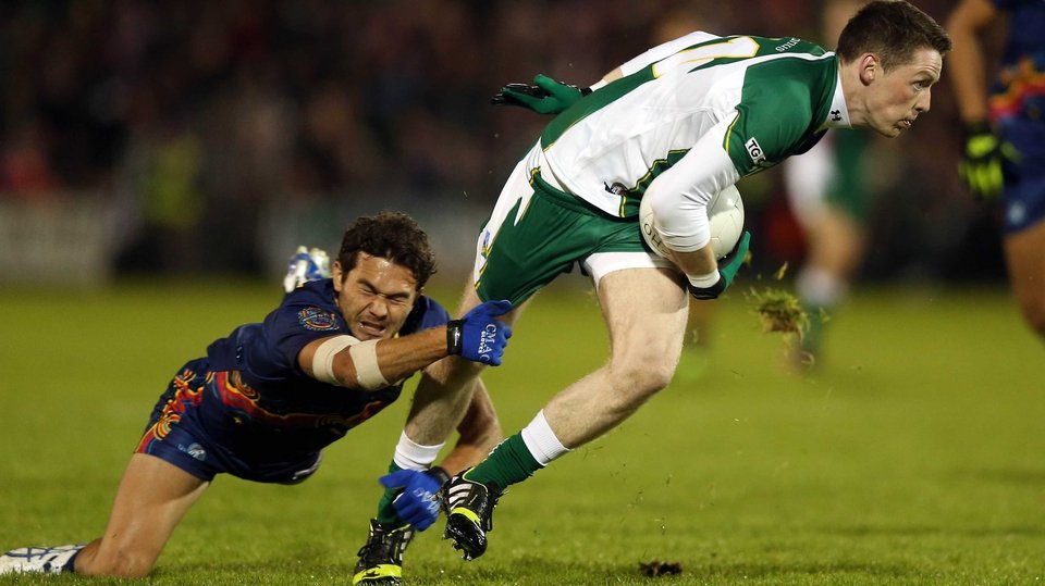Conor McManus tries to get away from Jarrod Harbrow of Australia