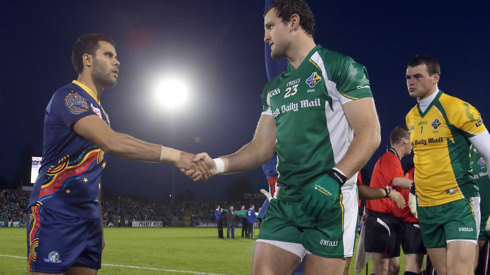 Captains Daniel Wells and Michael Murphy shake hands before the throw-in
