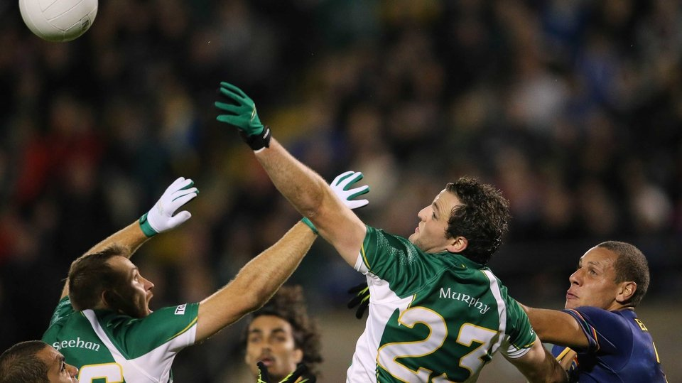 Michael Murphy contests a high ball under the attention of Cameron Ellis-Yolmen