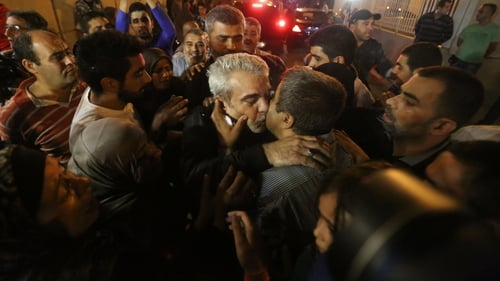 One of the nine Lebanese pilgrims abducted by rebels in Syria is welcomed home in Beirut after after 17 months in captivity