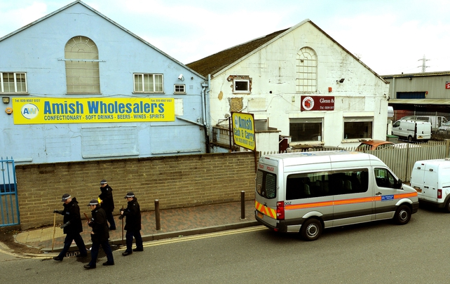 Police outside east London shop where owner Shammi Atwal was thrown under a passing lorry and killed after a robbery