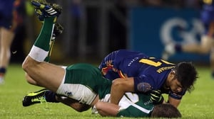 Ireland's Aidan O'Se and Sharrod Wellingham of Australia involved in an off the ball incident during the first Compromise Rules test in Cavan