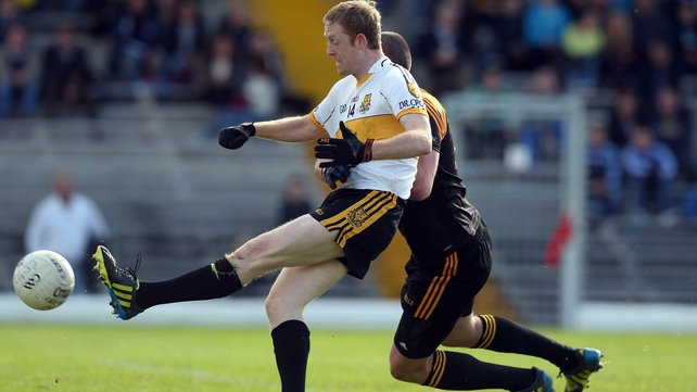 Dr Crokes' Colm Copper scores a goal despite the attention of Kerry team-mate Kieran Donaghy of Austin Stacks