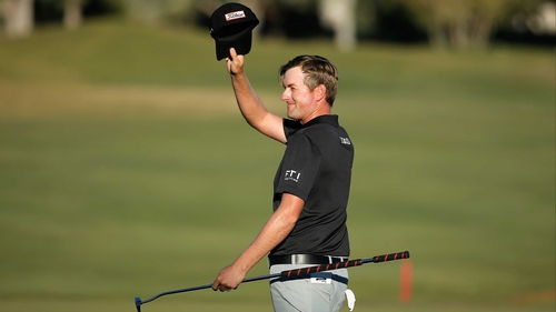 Webb Simpson celebrates a birdie on the 18th on his way to a six-stroke victory