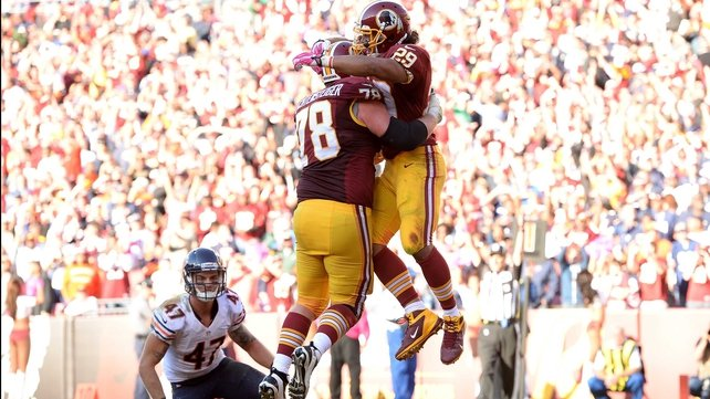 Roy Helu of the Washington Redskins celebrates his game-winning touchdown with teammate Kory Lichtensteiger