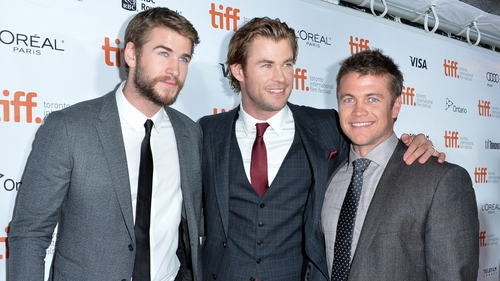 "Liam Hemsworth; Chris Hemsworth; Luke Hemsworth are ""competitive"" with his brothers"