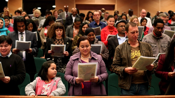 New Irish citizens taking place in a citizenship ceremony in October 2013