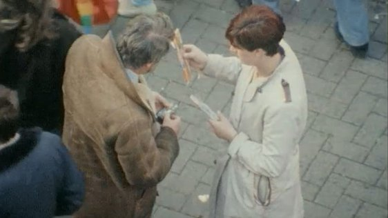 Eamon Ó Muirí buying fireworks on a street in Dublin.