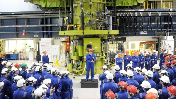 British Prime Minister David Cameron delivers a speech to workers in the Charge Hall at Hinkley Point B