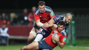 Felix Jones (holding ball) has been ruled out of Munster's clash with Glasgow next Friday