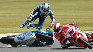 Julian Simon of Spain crashes his 60 Italtrans Racing Team Kalex during the Moto2 race at the Australian MotoGP