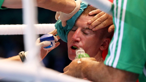 Paddy Barnes receives treatment to his head injury between rounds