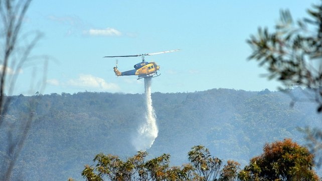 Helicopters douse water on bushland near Sydney