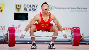 Lijun Chen from China lifts in the 62kg snatch competition at the IWF World Weightlifting Championships in Turkey