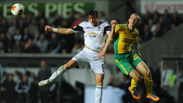 Swansea's Michu and Aleksei Kozlov of Kuban Krasnodar compete for the ball in tonight's Europa League clash