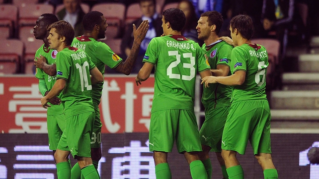 Rubin Kazan players celebrate their opening goal against Wigan