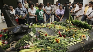 Salvadoreans visit the tomb of Archbiship Oscar Romero on the 33rd anniversary of his murder earlier this year