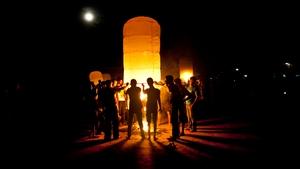 Buddhists light a large paper balloon into the sky during Probarona Purnima in Ramu, Bangladesh