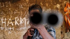 A labourer checks the barrel of a gun in a gun manufacturing factory in Kashmir