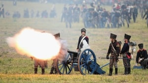 Historical society enthusiasts in the role of Prussian artillery soldiers fire against troops loyal to Napoleon during the re-enactment of The Battle of Nations on its 200th anniversary