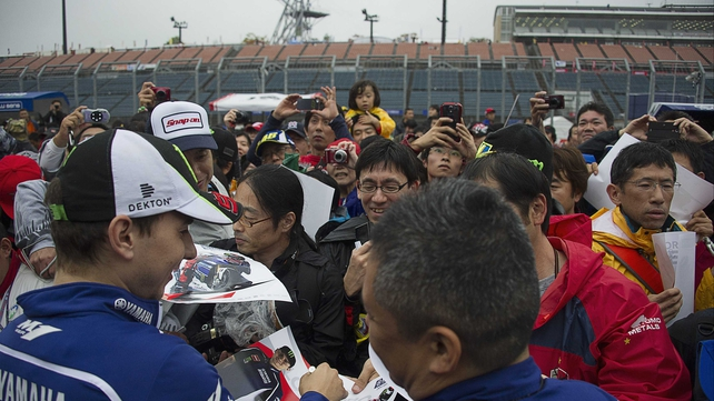 Jorge Lorenzo signs autographs during the pit walk in Japan