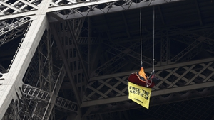 Greenpeace protests from Eiffel Tower over 30 detained in Russia