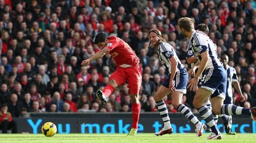 Luis Suarez scores the opening goal at Anfield