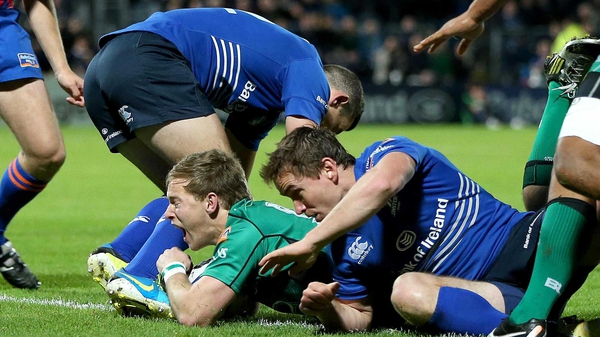 Kieran Mannion scores the first try of the game at the RDS