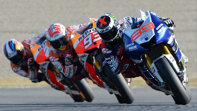 Yamaha's Jorge Lorenzo (R) leads Marc Marquez and Dani Pedrosa on his way to victory