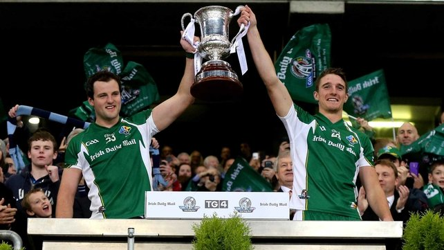 Michael Murphy and Aidan Walsh lift the Cormac McAnallen Cup