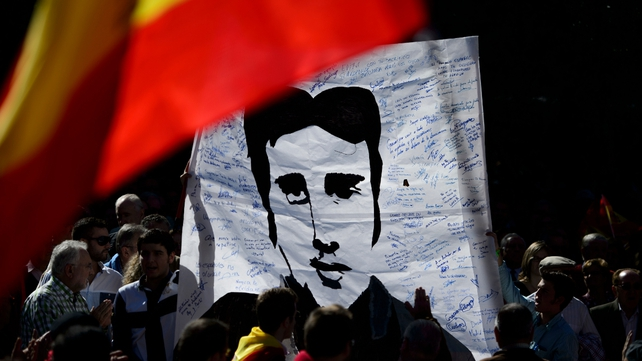 People display a portrait of Basque Popular Party councillor and victim of ETA Miguel Angel Blanco