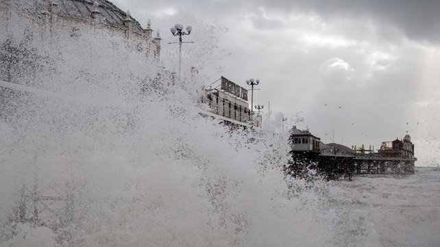 Waves crash near Brighton Pier in East Sussex, as England and Wales face a battering tonight from the worst storm in five years