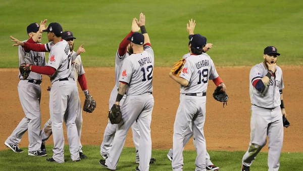 The Boston Red Sox celebrate as the series goes to 2-2