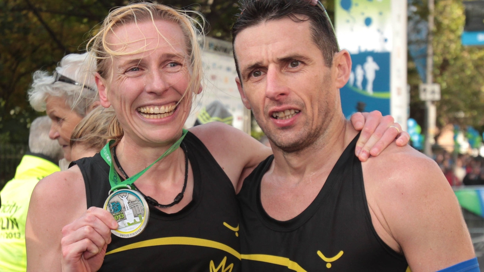 Women's winner Maria McCambridge with her husband Gary Crossan after crossing the finish line