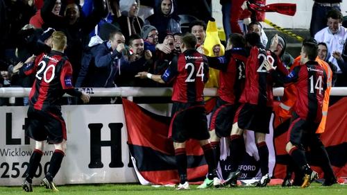 Longford celebrate scoring the equalising goal