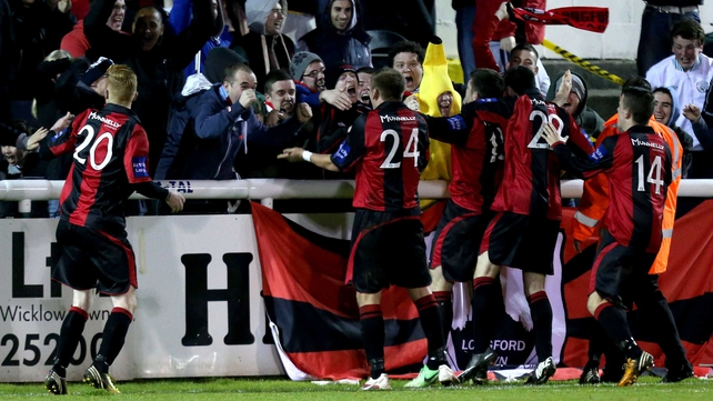 Longford celebrate scoring the equalising goal
