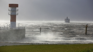 A cargo ship rides at anchor at the mouth of river Elbe in Brunsbuettel, northern Germany