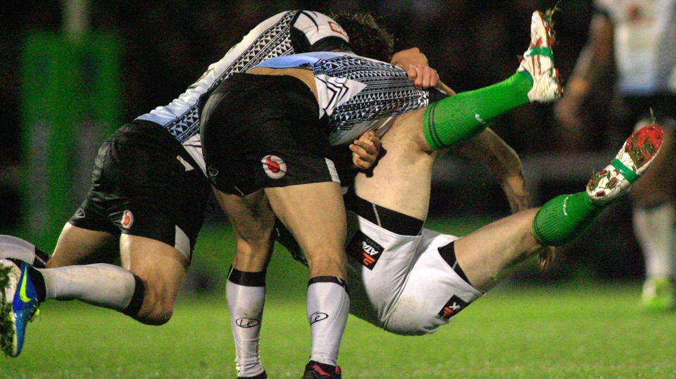 Fiji's Ashton Sims and Aaron Groom tackle Eamon O'Carroll of Ireland during their Rugby League World Cup clash in Rochdale