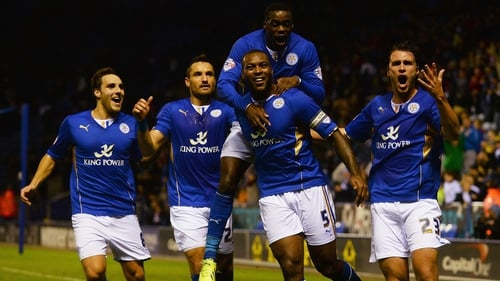 Wes Morgan (centre) of Leicester City is mobbed by team-mates after scoring Leicester's first against Fulham