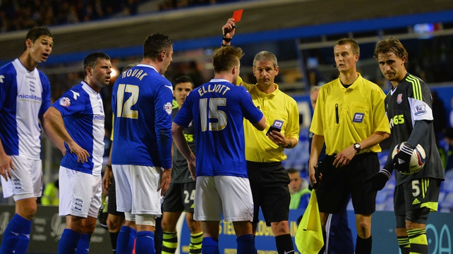 Referee Simon Hooper shows Birmingham's Wade Elliott a red card