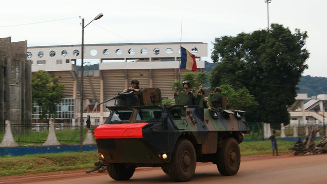 French soldiers patrol aboard a military vehicle on a street in Bangui