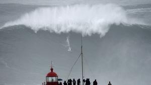 Brazilian big wave surfer Carlos Burle rides a wave in Nazare, central Portugal