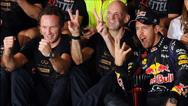 Sebastian Vettel (R) celebrates with technical director Adrian Newey (C) and team prinicipal Christian Horner (L)