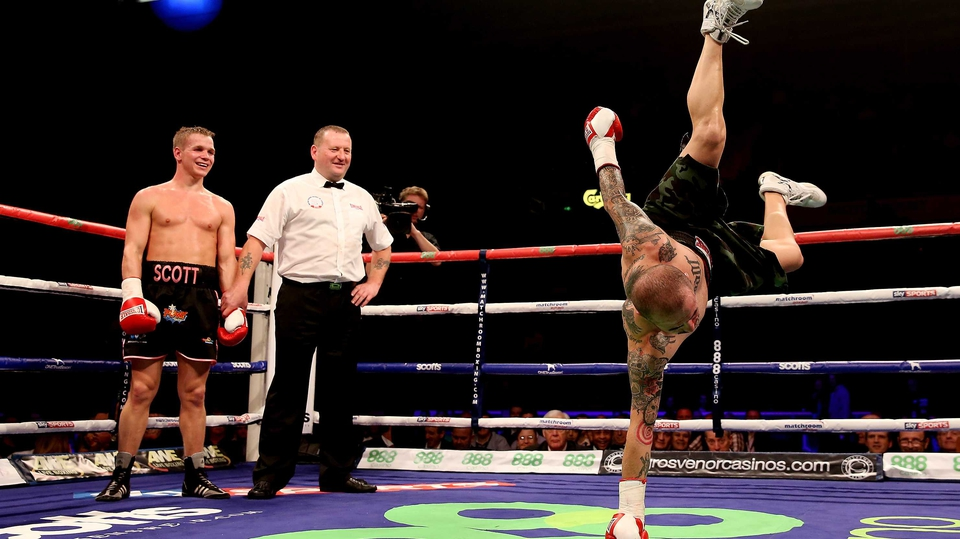Antonio Rodriguez dances in the ring as Scott Jenkins celebrates his victory during their lightweight bout at Motorpoint Arena