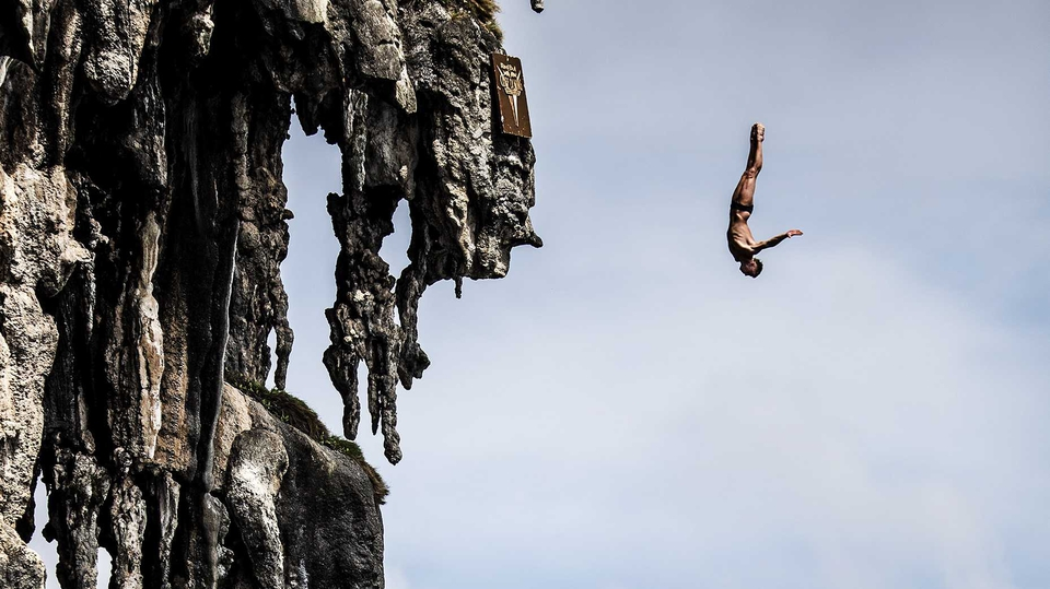Artem Silchenko of Russia dives at Viking Caves in the Andaman Sea at the Cliff Diving World Series at Phi Phi Island, Thailand