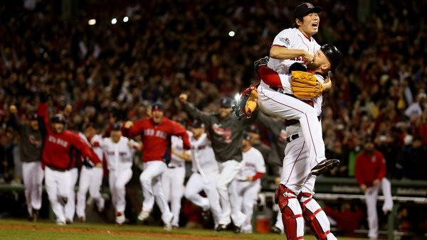 Koji Uehara #19 of the Boston Red Sox celebrates with David Ross